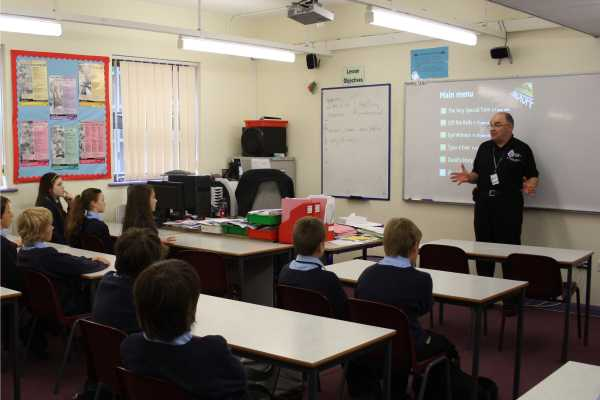 A representive of the Transport Police talks with year 7 students