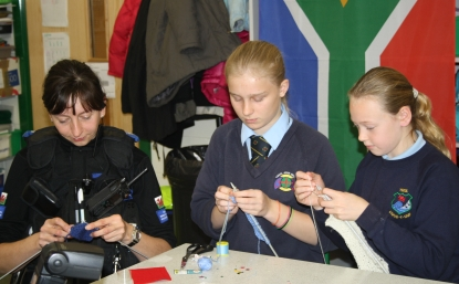 Police officer knits with students