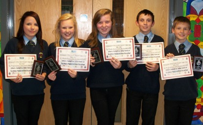 The winners of the quiz proudly display their certifcates